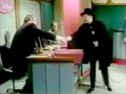 Mel Brooks (right) as the 2,000-Year-Old Man, greeting contestant Burns Cameron on episode #2000